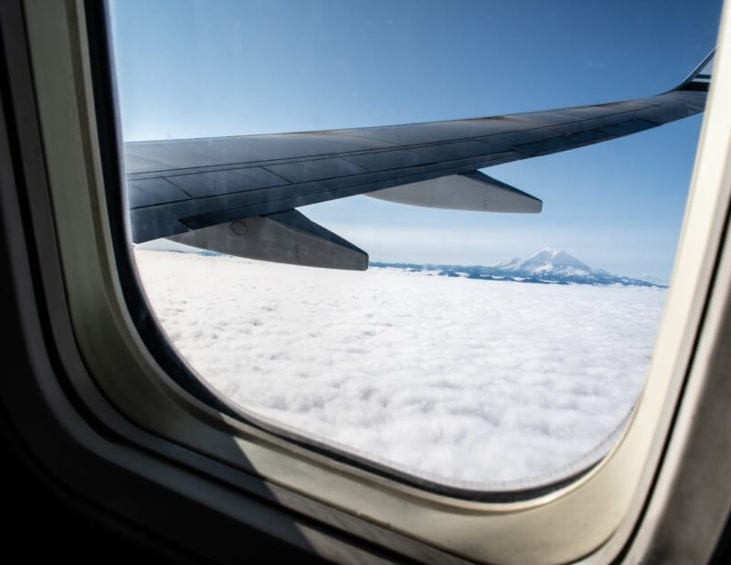 airplane wing with mountain
